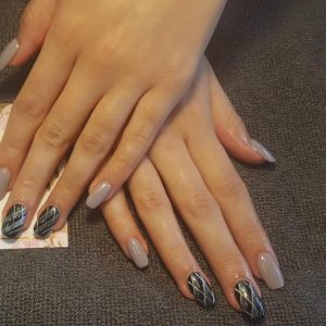acrylic nail extensions with shellac gel colour and designs on top